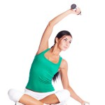 beautiful young  woman with dumbbells, isolated against white background